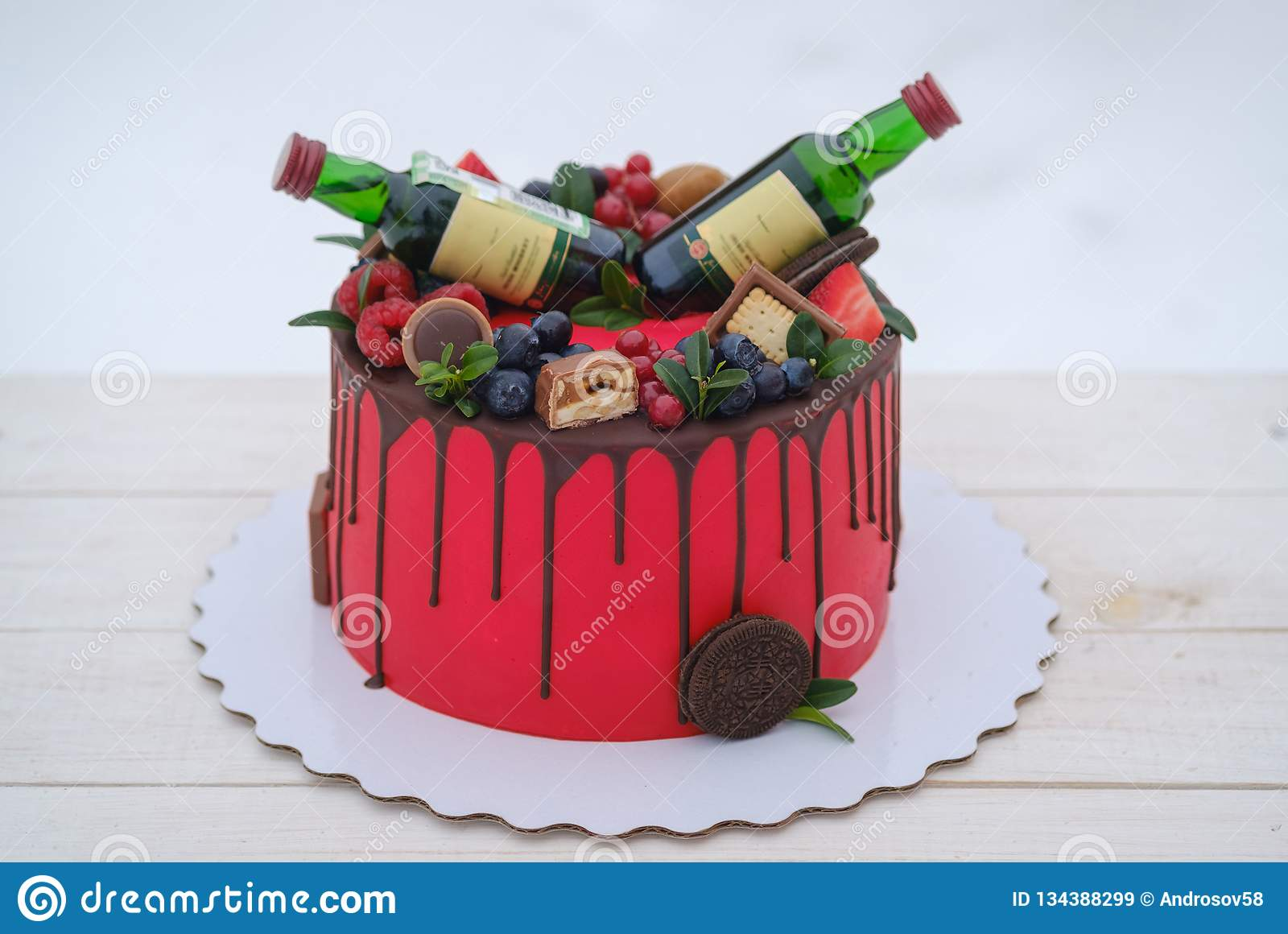 Surprising Birthday Cake With Red Cream And Two Bottles Of Cognac Stock Image Personalised Birthday Cards Epsylily Jamesorg