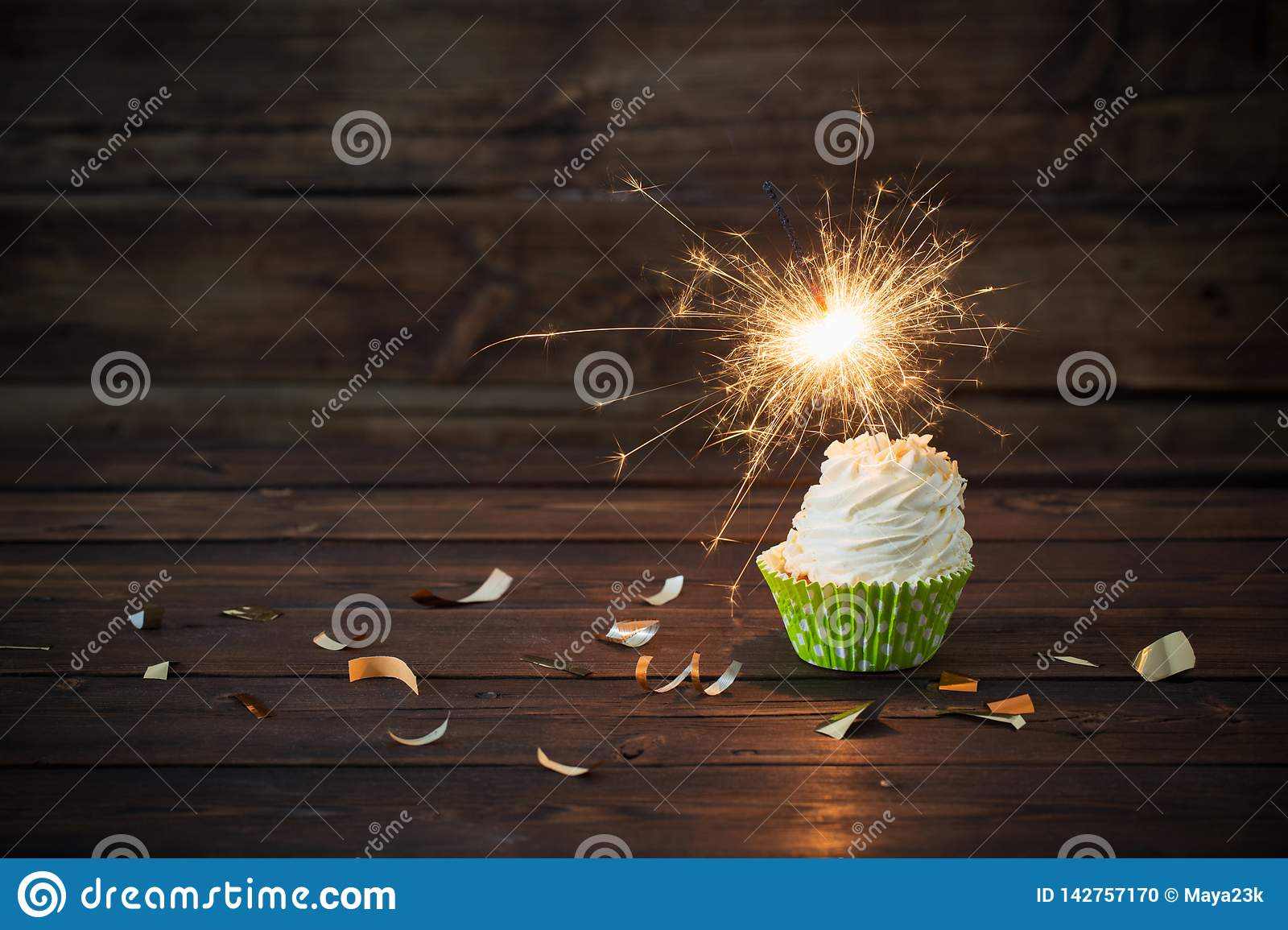 Birthday Cake With Sparkler On Old Wooden Background