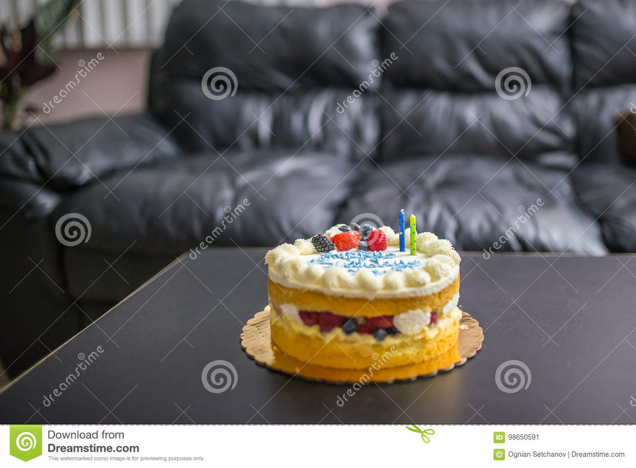 Birthday Cake With Two Candles On A Black Table