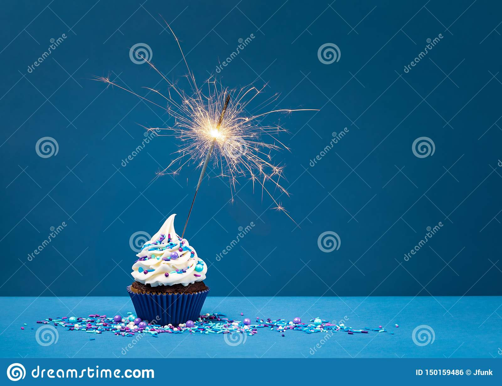 Birthday Cupcake on blue with sparkler