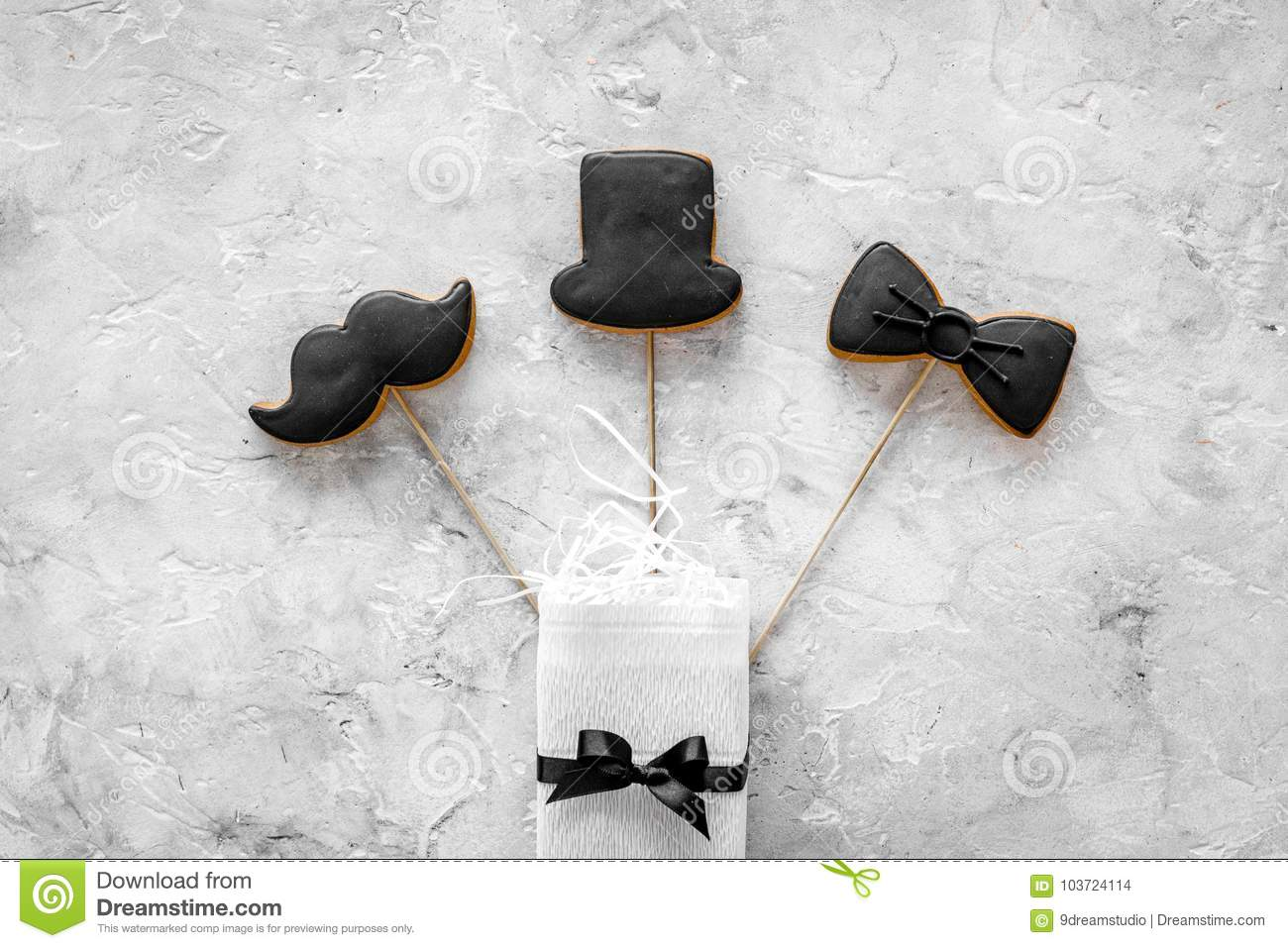 Birthday Gift For Men Wrapped Box Cookies In Shape Of Black Tie Mustache Hat Grey Background Top View