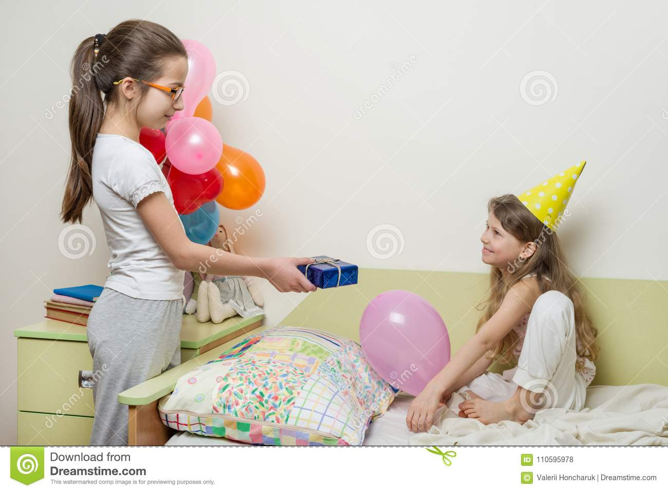 Birthday Morning Older Sister Giving Surprise Gift To Her Cute Little Children At Home In Bed