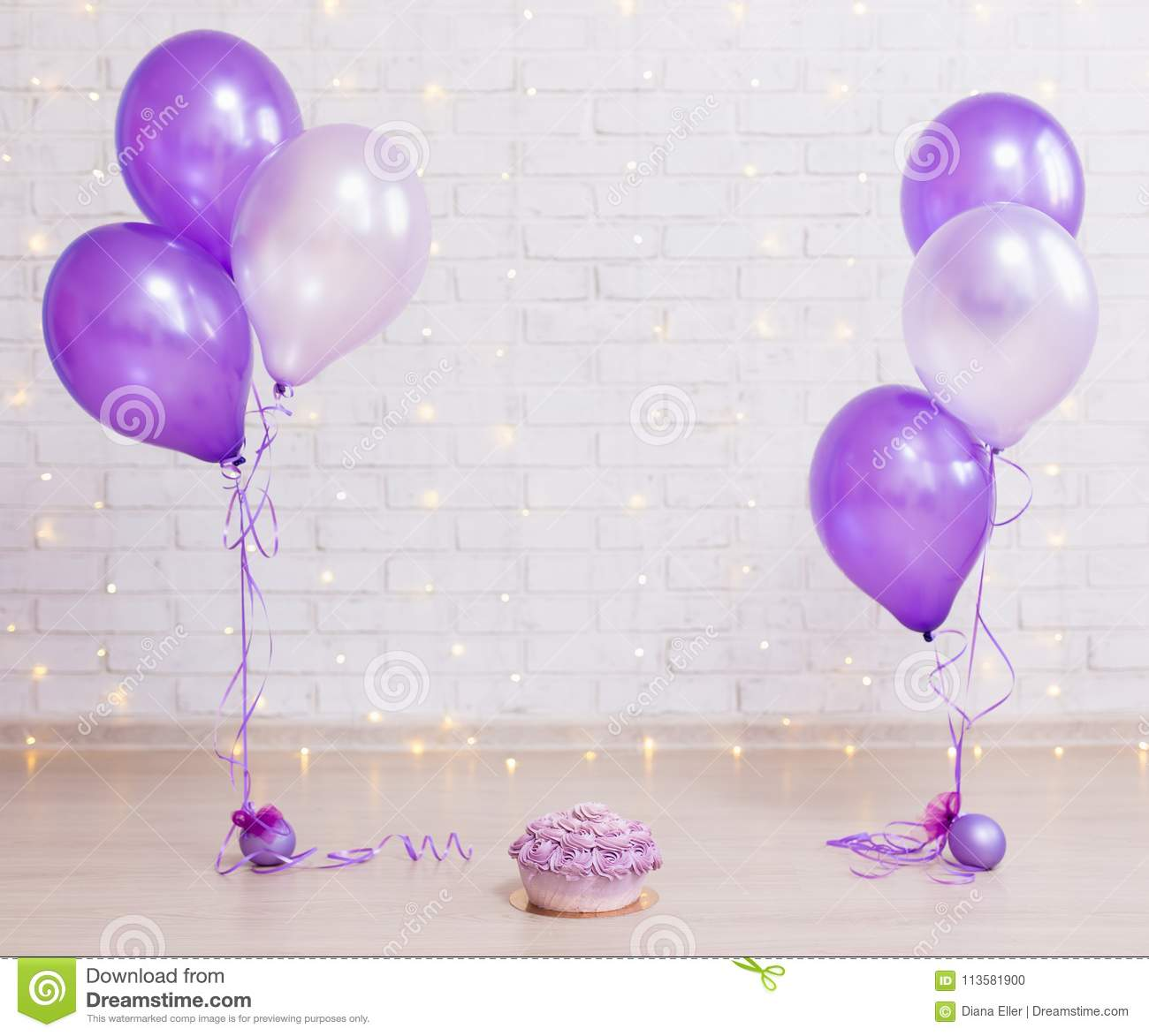 Birthday party concept - cake over brick wall background with li