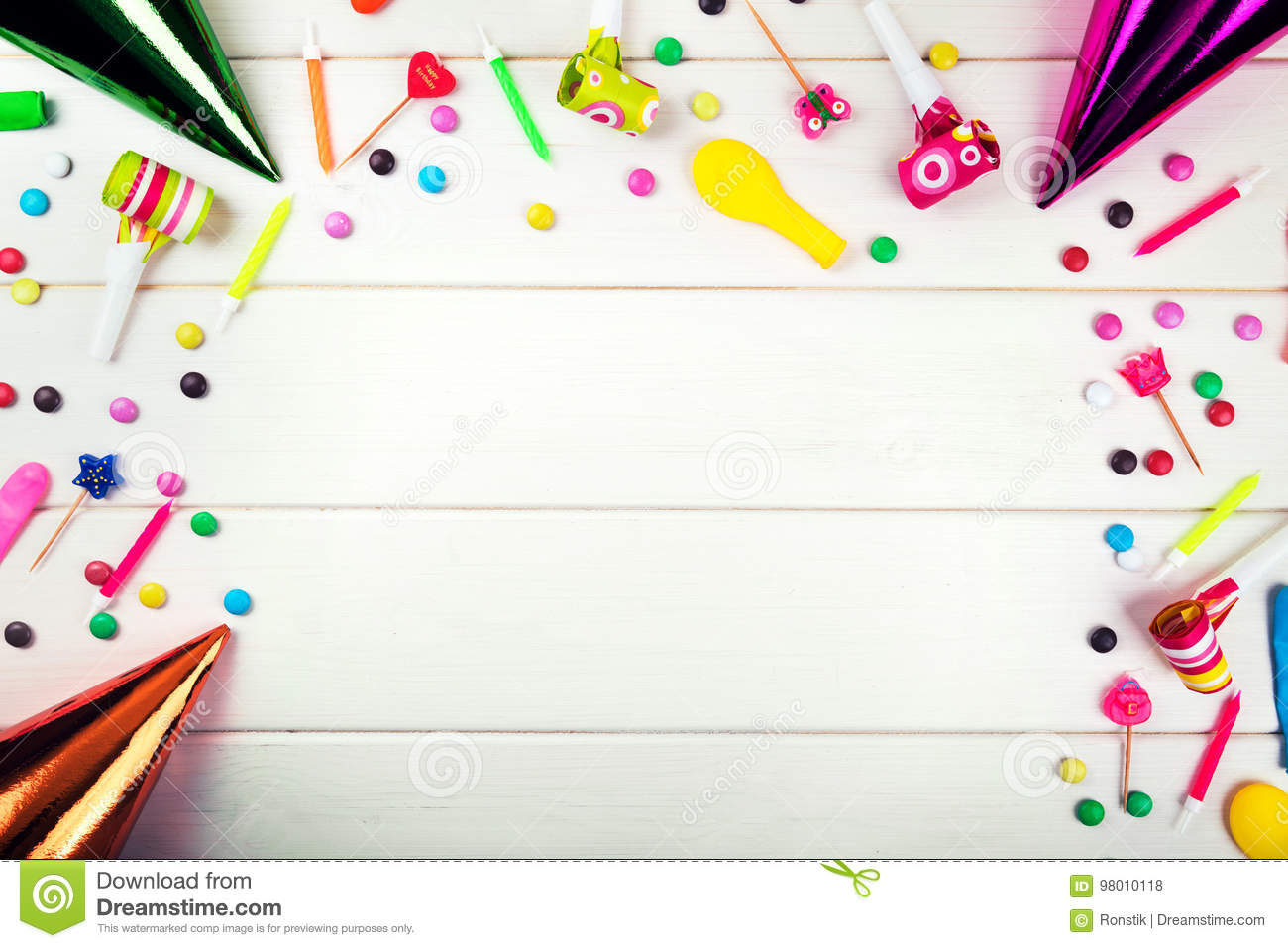 birthday party items and decorations on white wood background