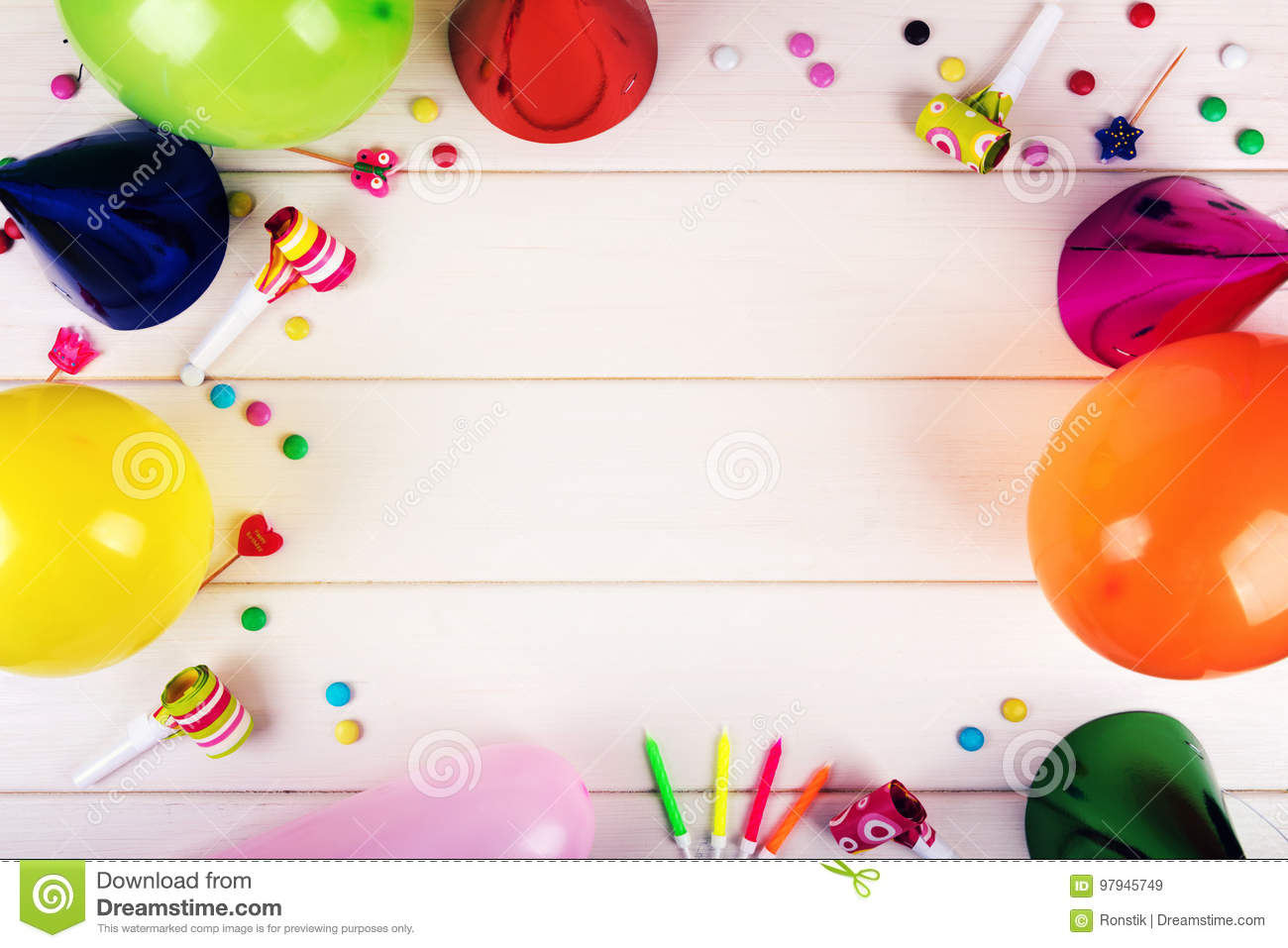 birthday party items on white wooden background