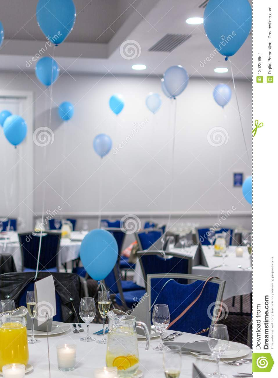 Birthday Party Set Up With White Stylish Tablecloth And Coloured Balloons