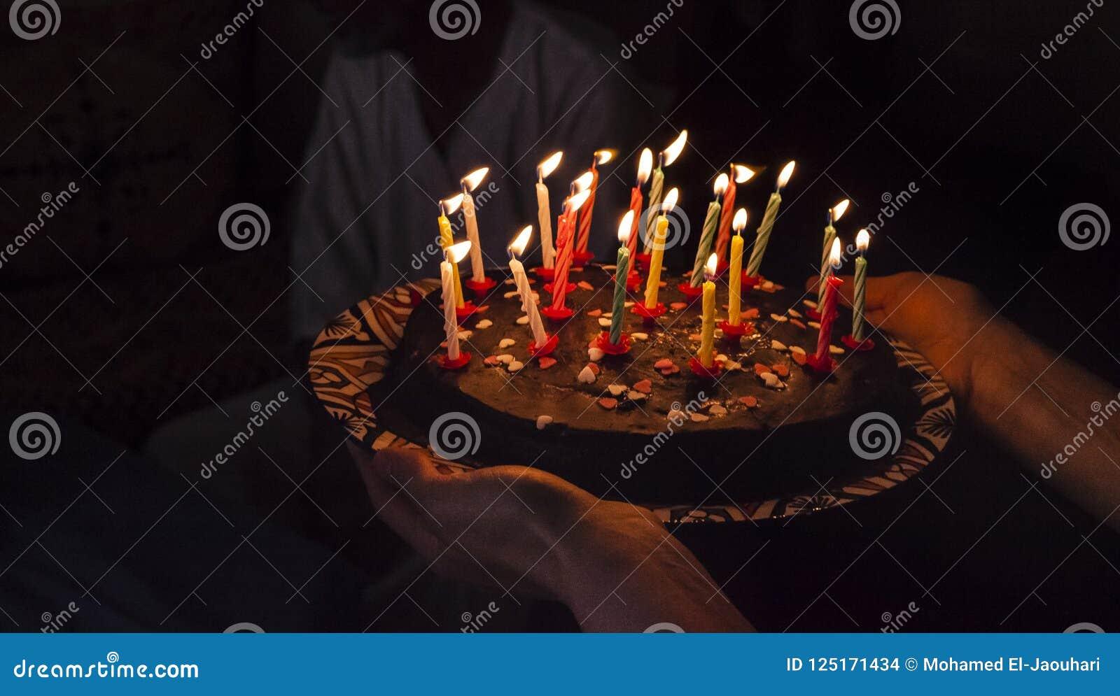 Pleasing Birthday Surprise Cake With Candles In Darkness Stock Photo Funny Birthday Cards Online Amentibdeldamsfinfo