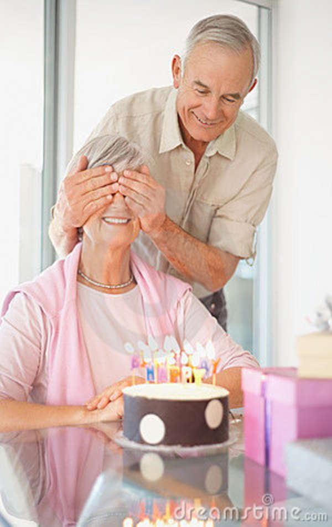 Senior Man Surprising His Wife Stock