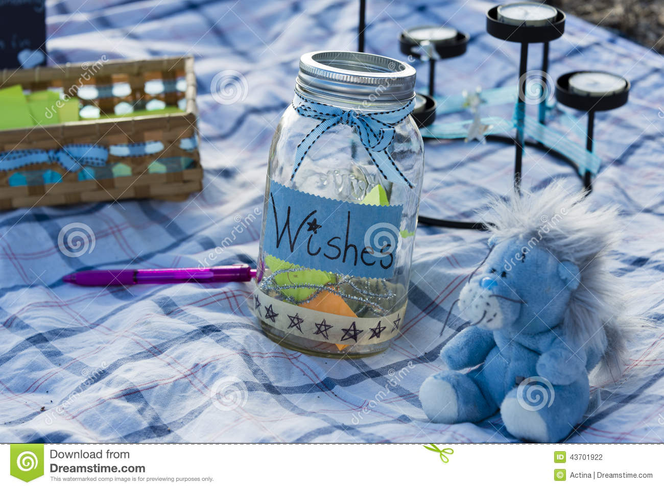 Birthday Decoration At Party With Wish Jar And Blue Lion Plush Toy On Checkered Tablecloth