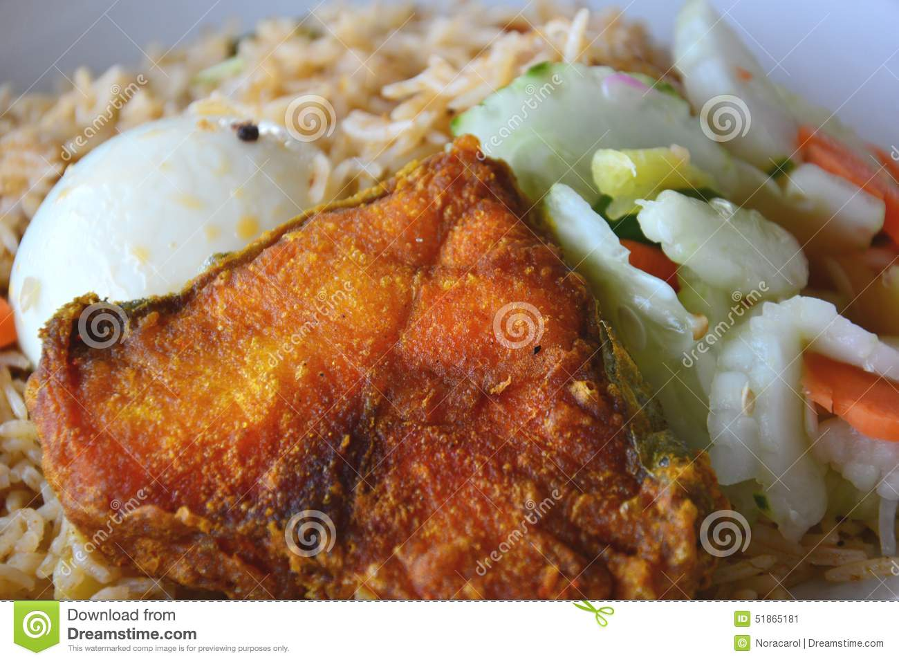 Biryani rice with fried fish egg and salad stock photo for Rice dishes with fish