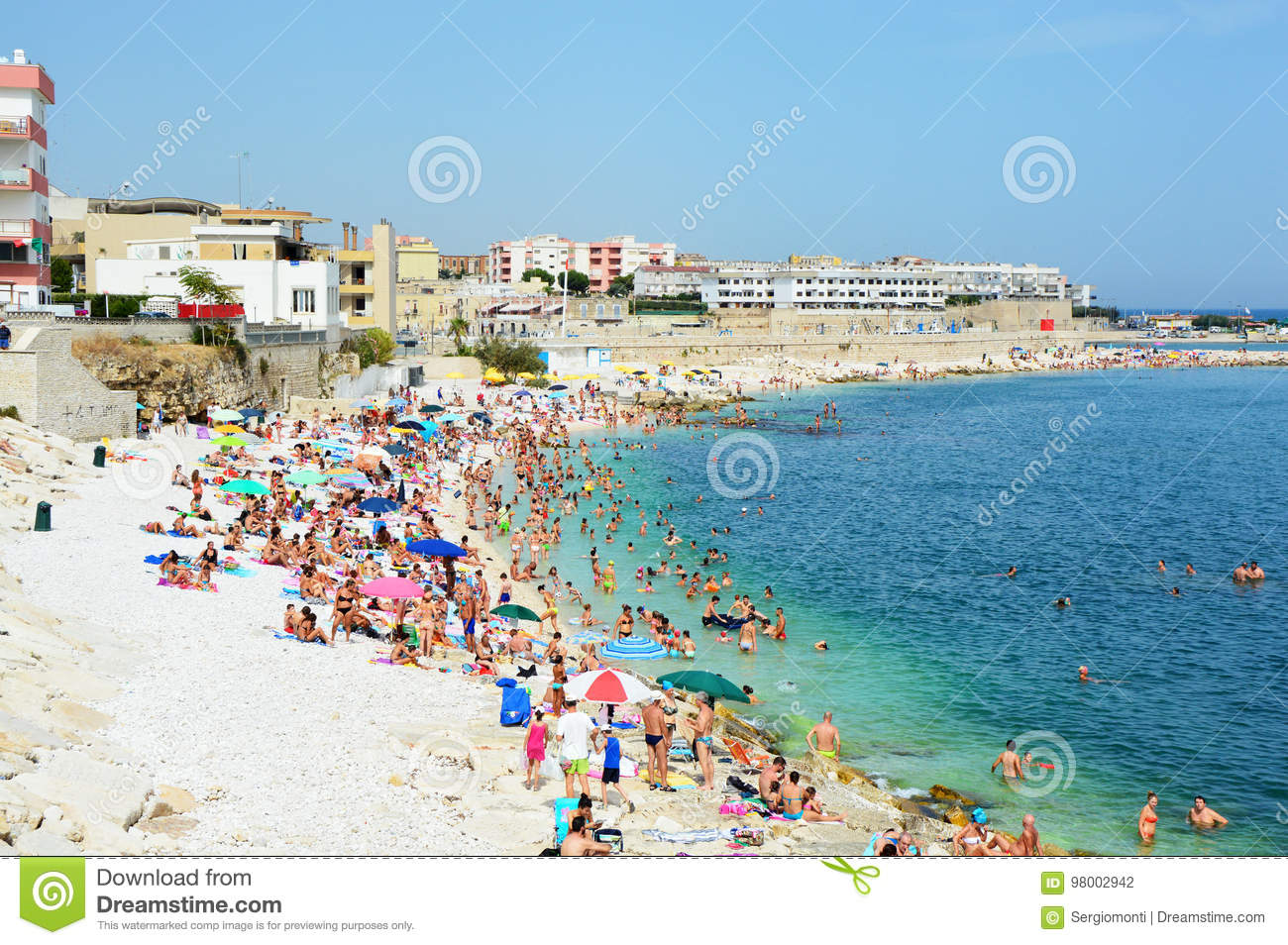 BISCEGLIE, ITALY - AUGUST 3, 2017: Very Crowded Beach Full Of People At The  Mediterranean Sea In Apulia Turist Region, Bisceglie Editorial Photography  - Image of resort, city: 98002942