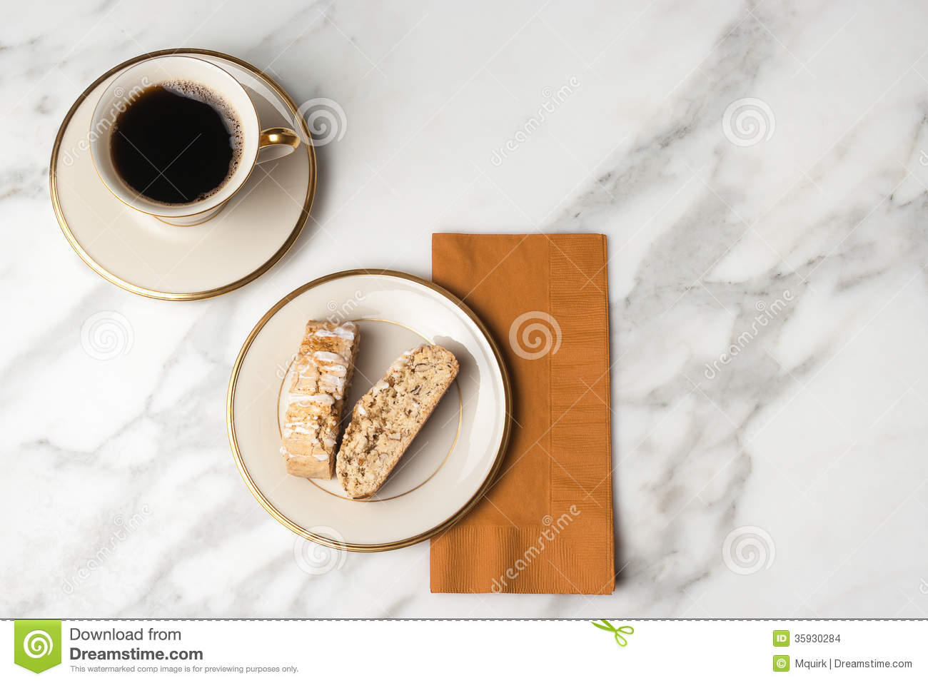 Biscotti On A Plate With A Cup Of Coffee Stock Images