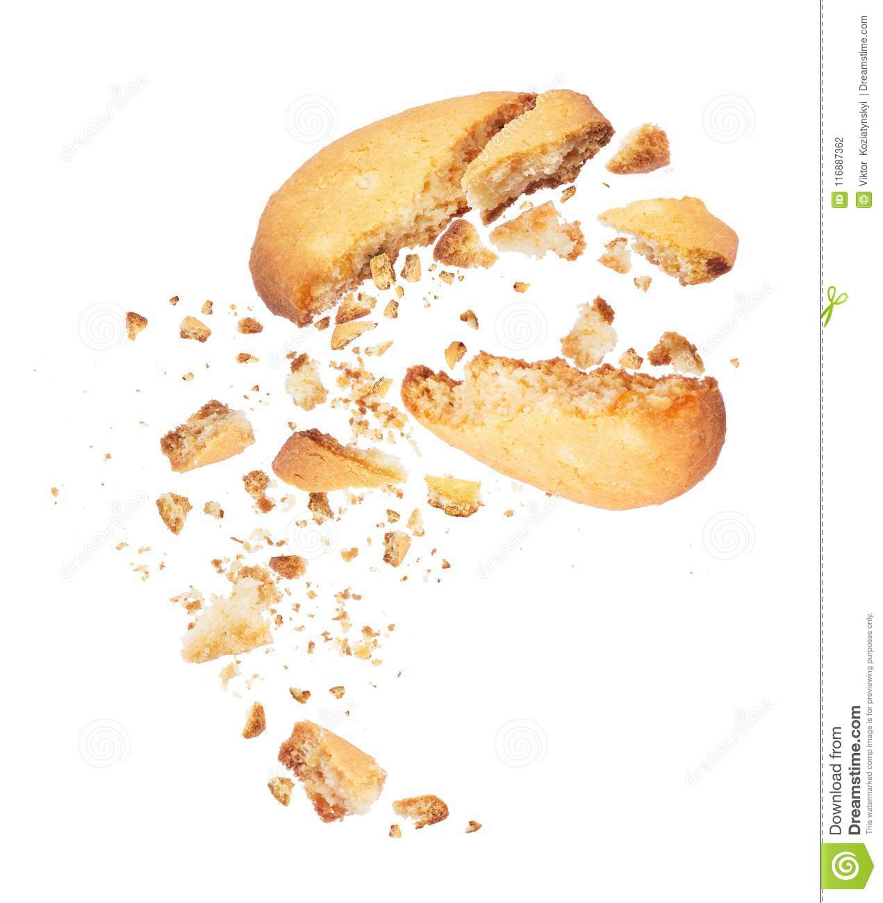 Biscuit broken into two halves with falling crumbs down