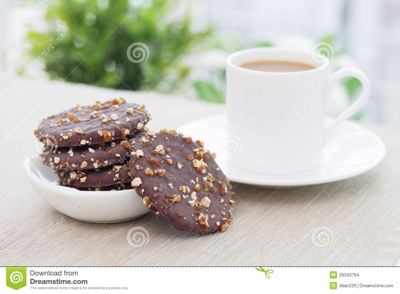 Coffee and biscuits on the table.