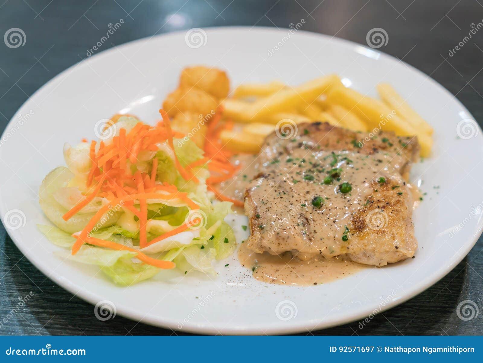 Bistecca del pollo e salsa dei peperoni