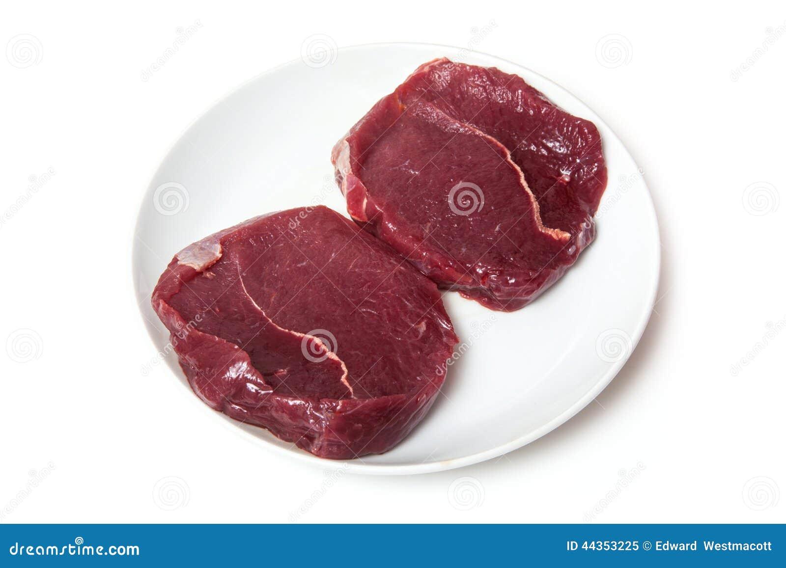 Bistecche crude della zebra su un piatto