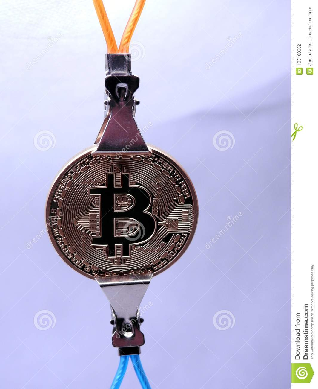 Bitcoin Hanging On Two Metal Clips Stock Photo - Image of