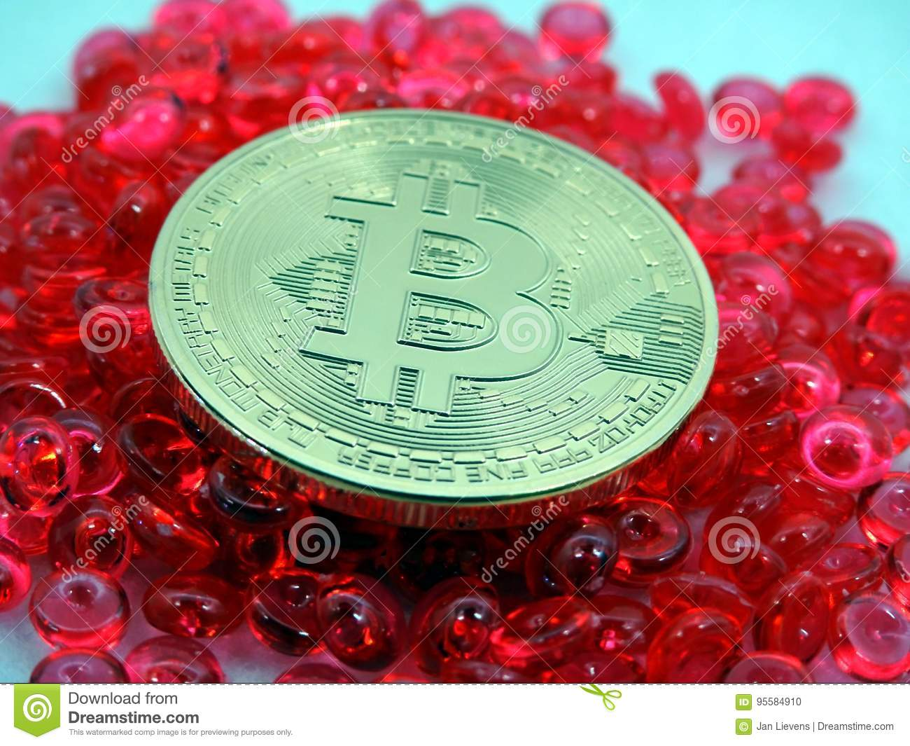 Bitcoin coin on top of red beats