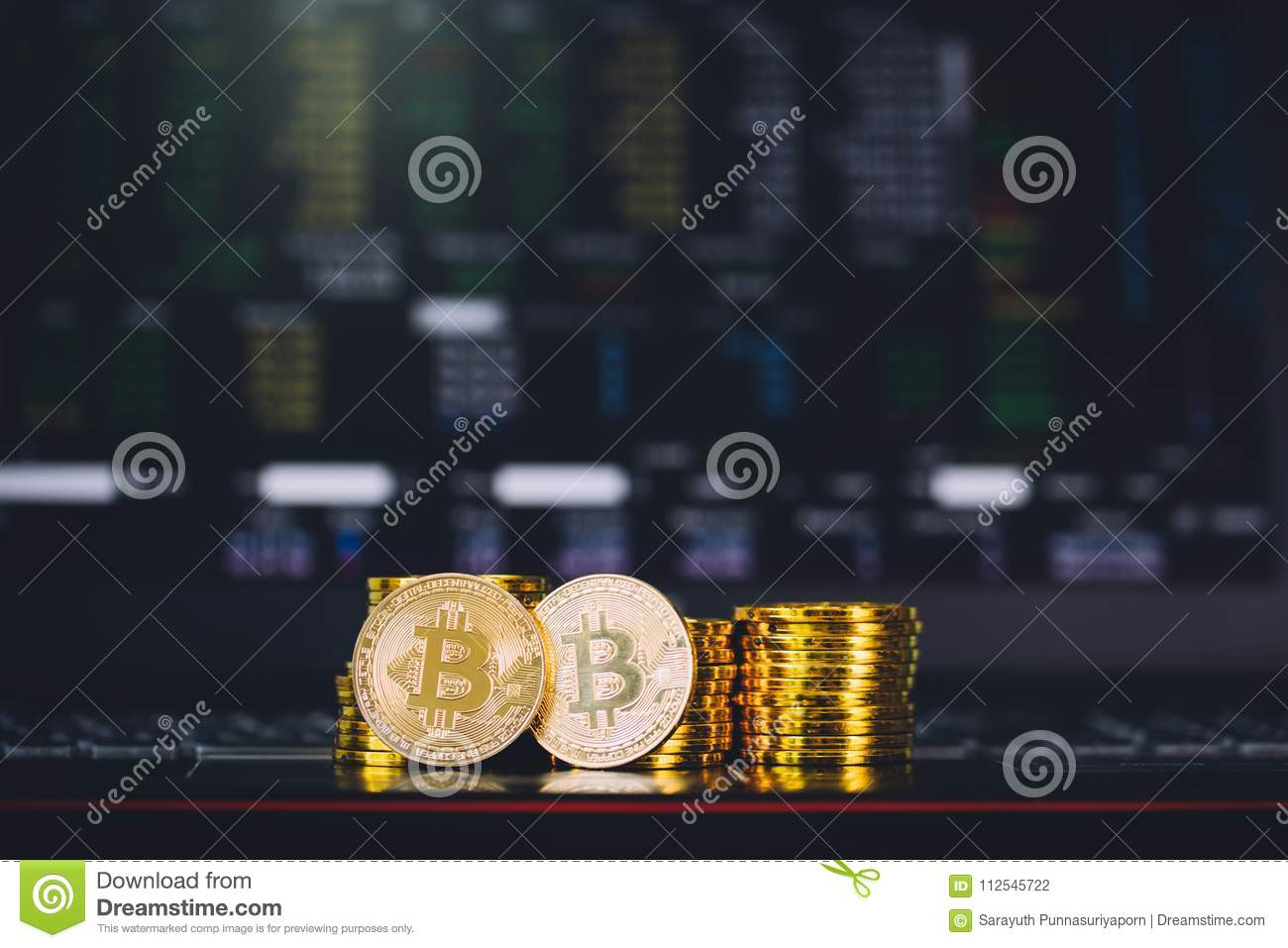 Bitcoin Coins Pile And Two Bit Coins Sitting In Front With
