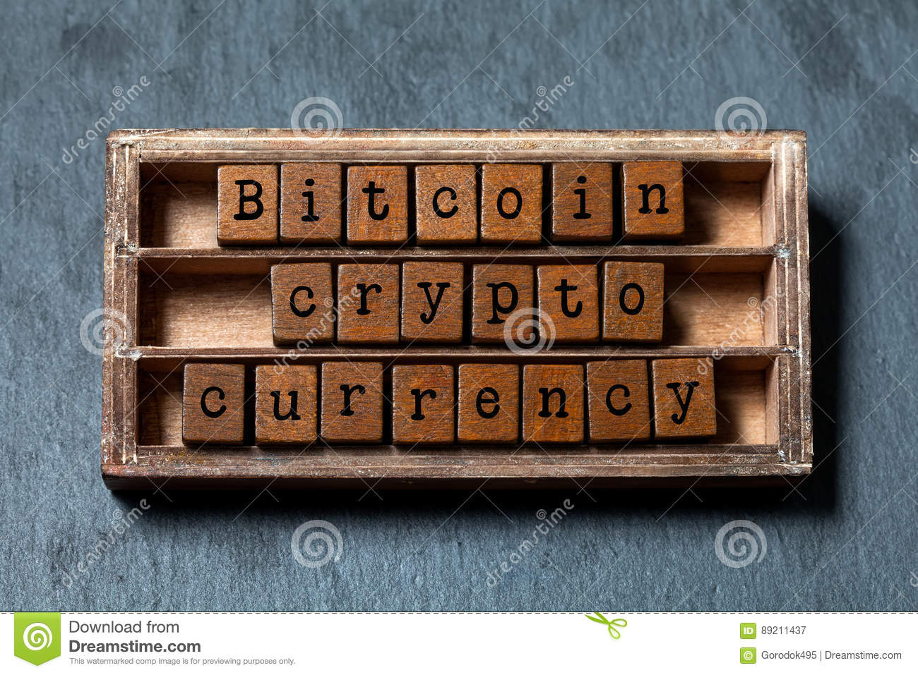 Bitcoin crypto currency and digital money concept. Vintage box, wooden cubes phrase with old style letters. Gray stone