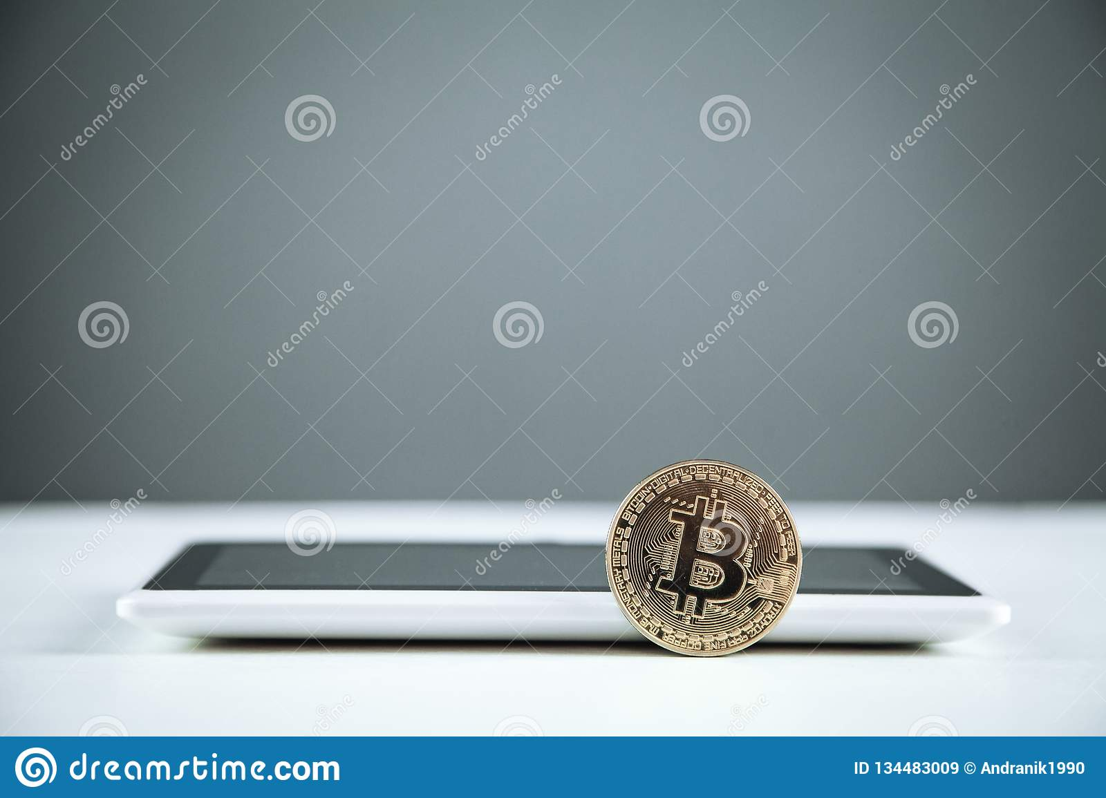 Bitcoin with digital tablet. Technology, Commercial and Finance concept