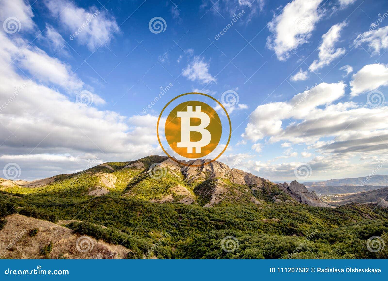 Bitcoin em uma parte superior da montanha