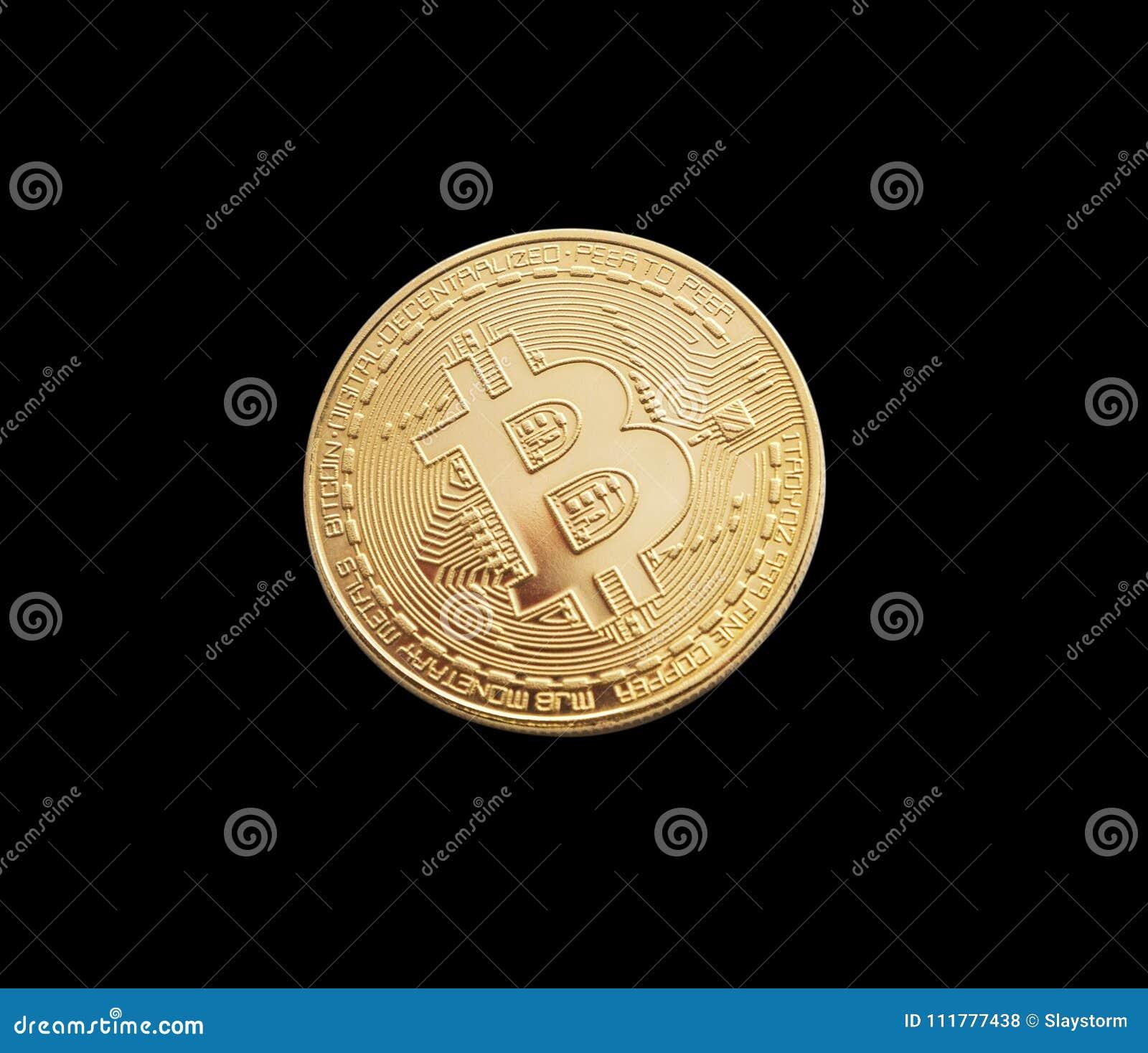 Bitcoin. Golden bitcoin isolated on black background