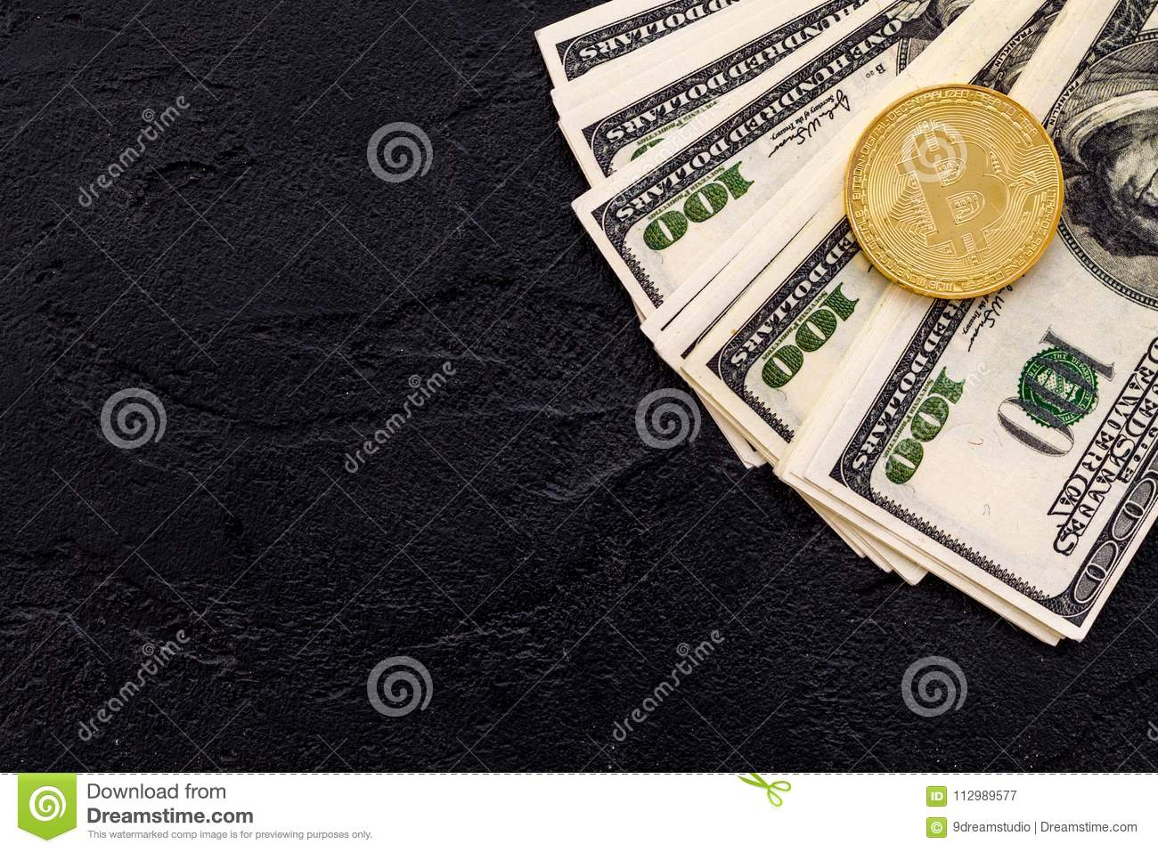 Bitcoin with international currency banknotes on black background top view space for text