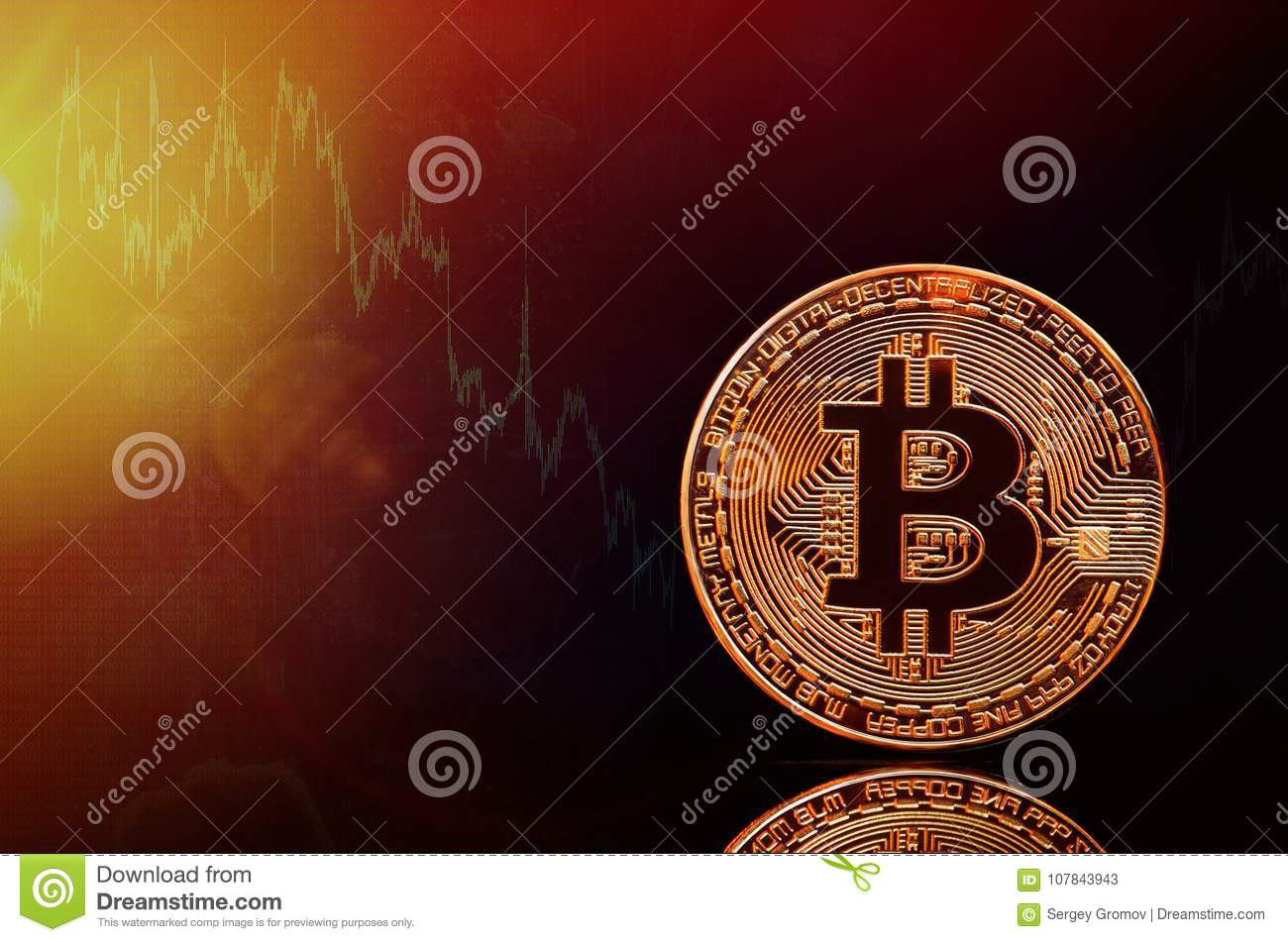 Bitcoin and the new concept of virtual money. Gold bitcomes with graphics and digital background. Gold coin with the letter of the