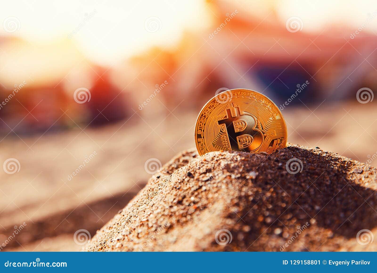 Bitcoin på guld- sand