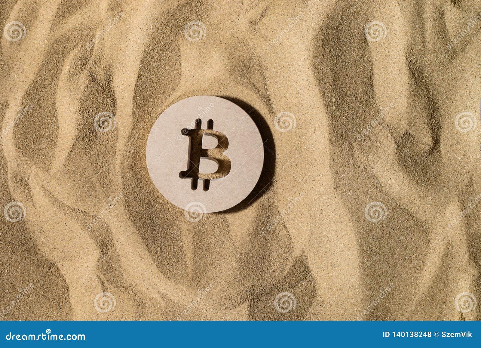 Bitcoin znak Na piasku