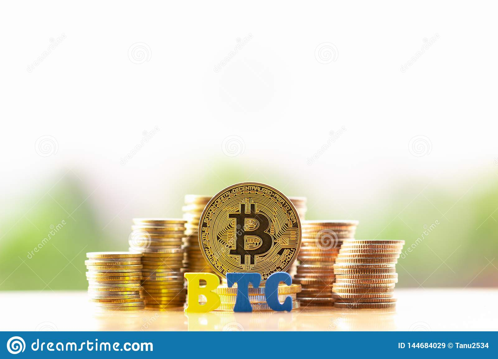 BitcoinBTC Golden And Wooden Block BTC On Greenery Nature Background