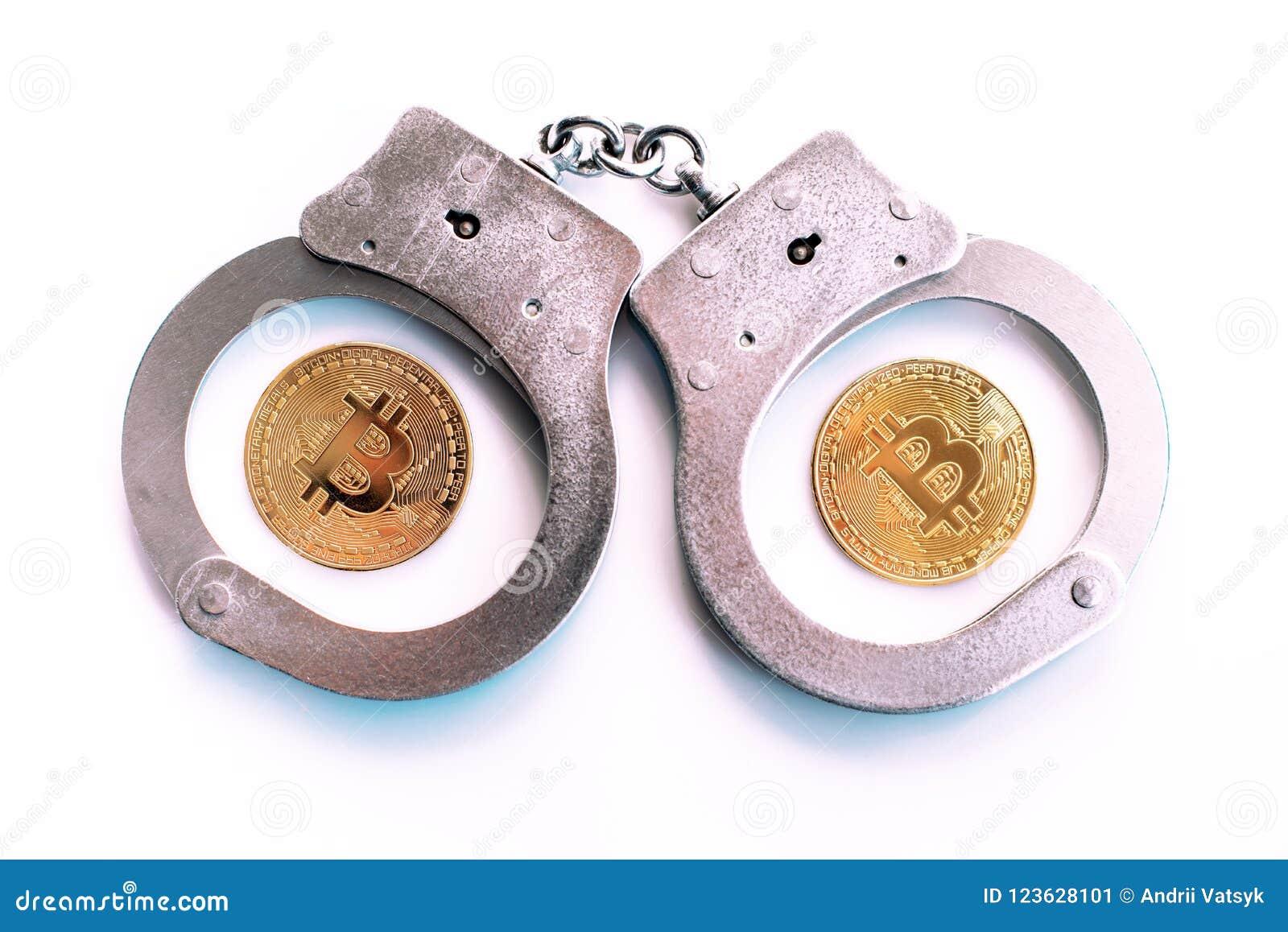 Bitcoins en handcuffs als een abstract symbool van misdaad dat h kan
