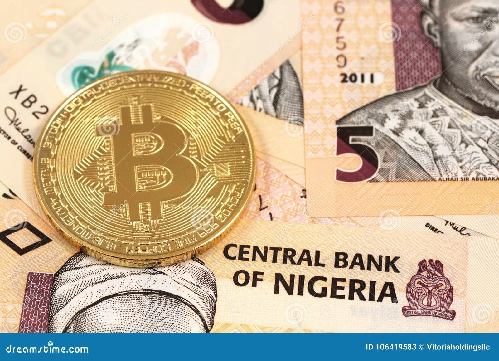 Bitcoins with Nigerian naira close up