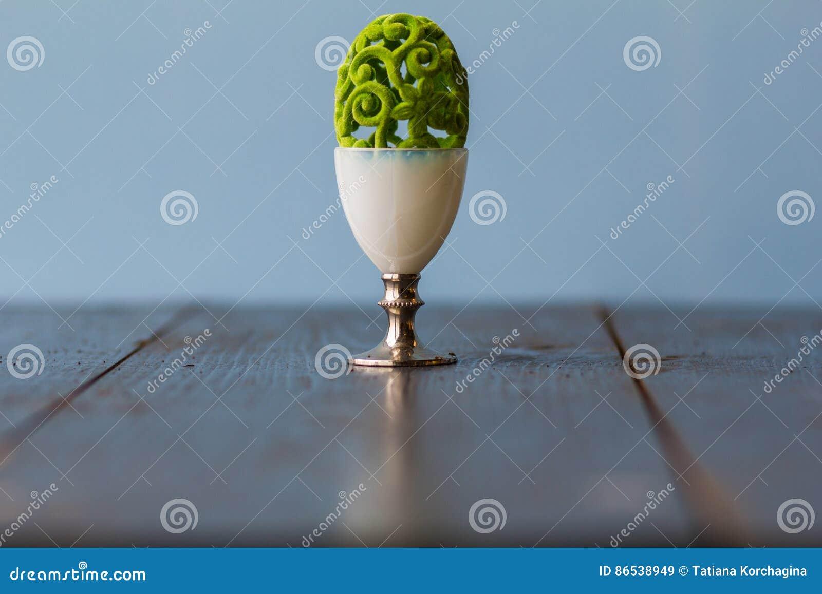 Bizarre delicate Easter decorative openwork egg in a special egg