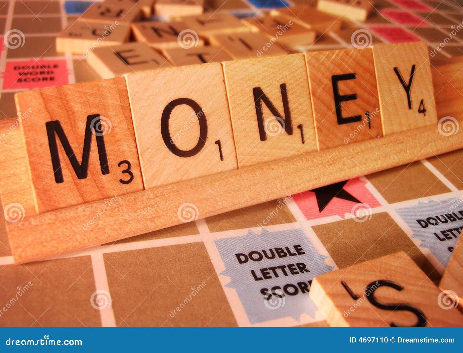 Biznes koncepcji pieniądze scrabble słowo