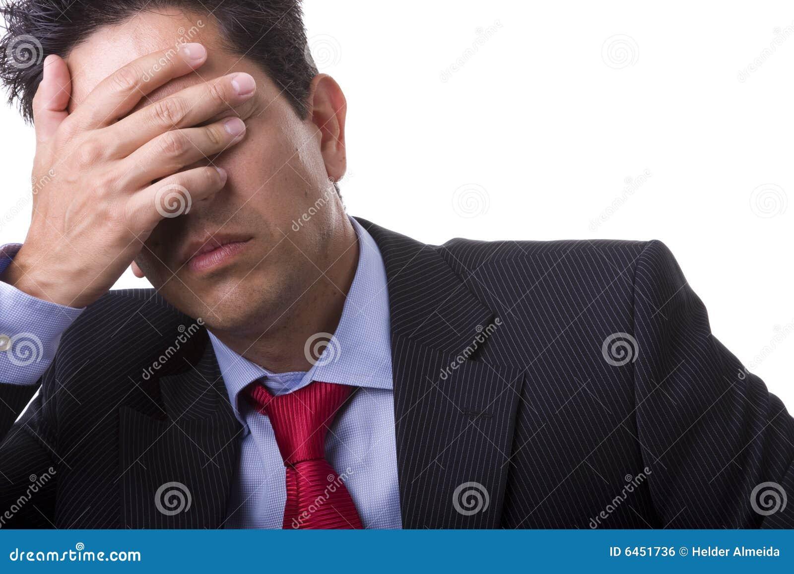 Biznesmen ból głowy.