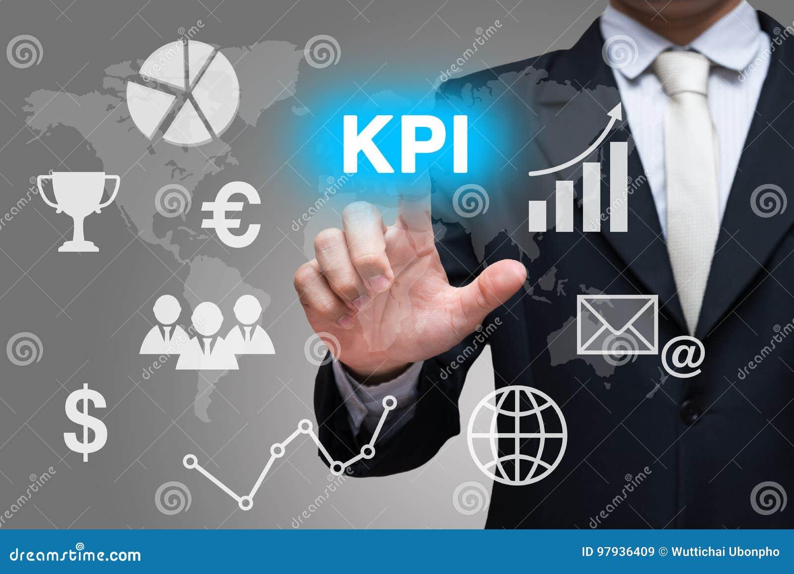 Biznesmen ręki dotyka KPI symbole na szarym tle