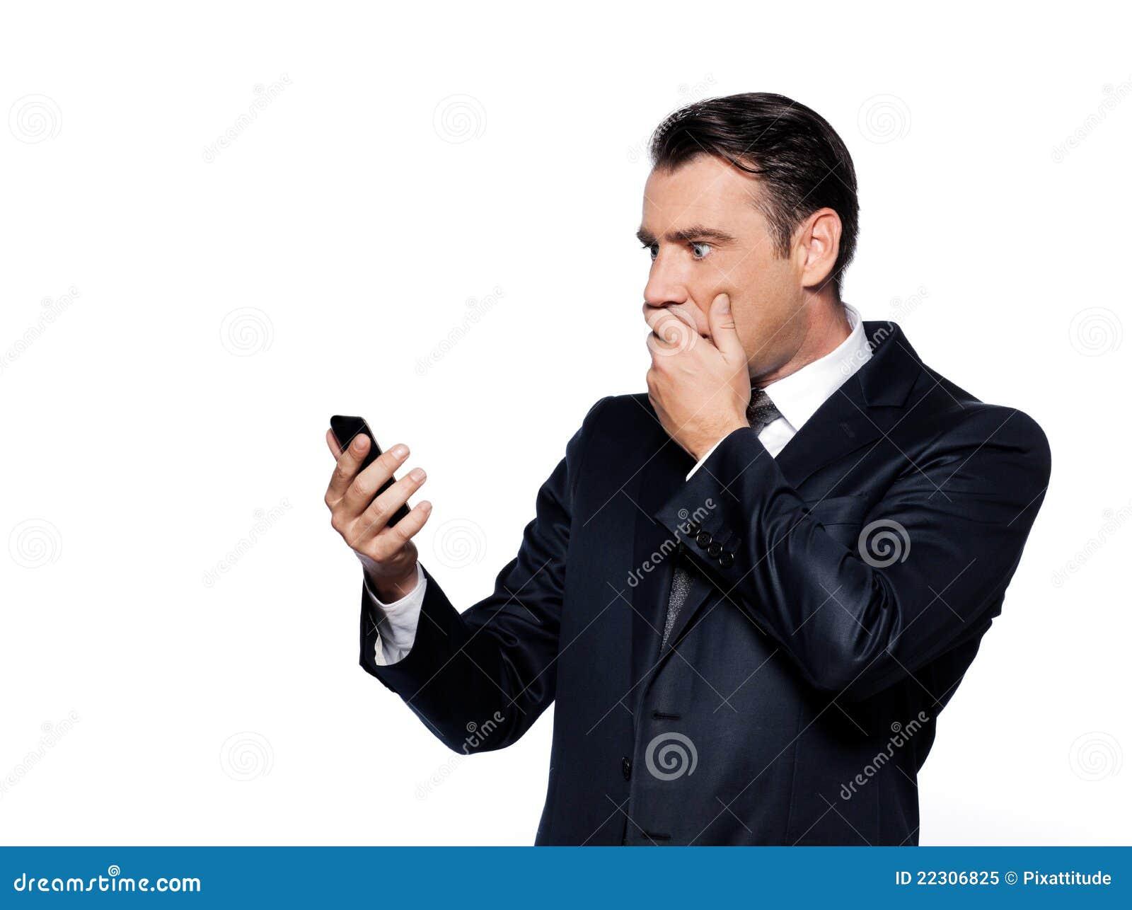 Biznesowego mężczyzna telefon szokujący