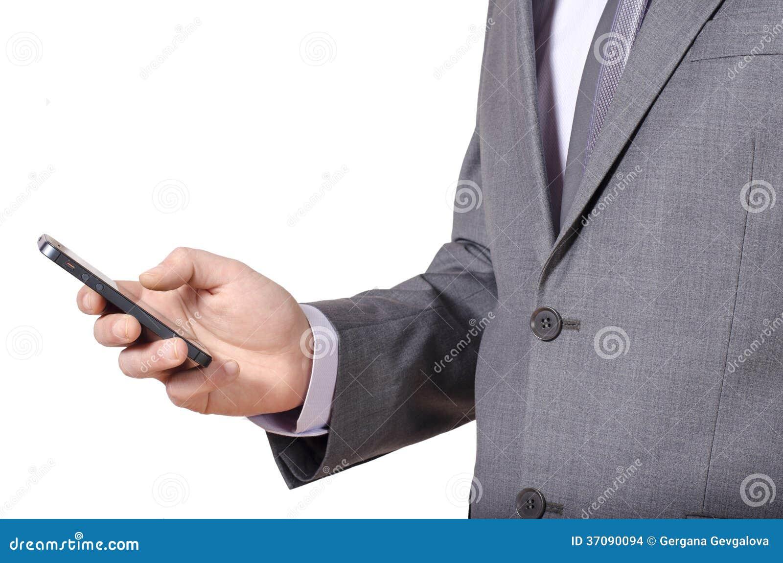 Download Biznesowy Mężczyzna W Popielaty Kostiumu Texting Zdjęcie Stock - Obraz złożonej z hairball, jeden: 37090094