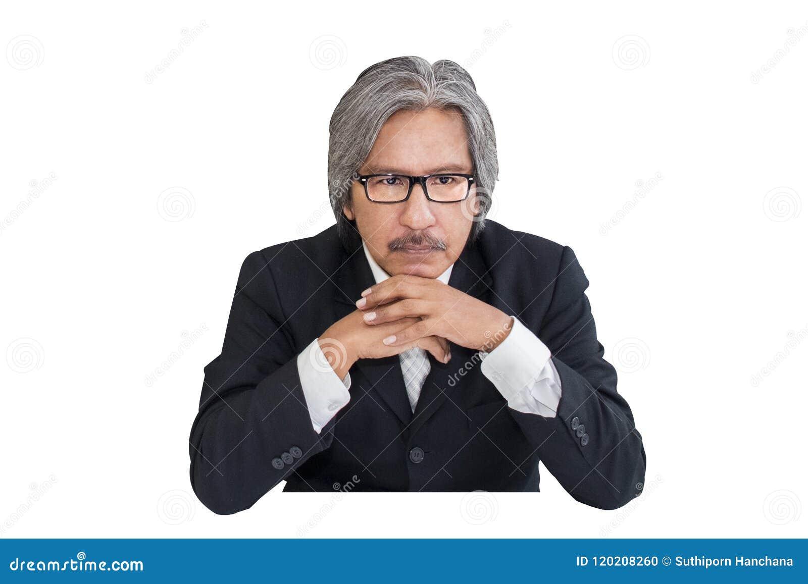 Biznesowy starszy stary człowiek poważny w biurowym działaniu
