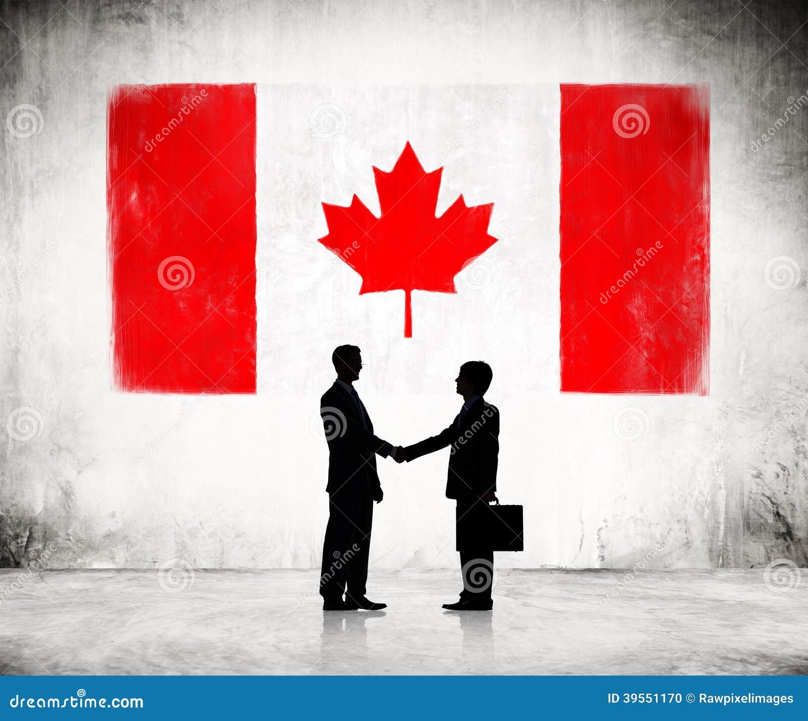 Biznesowy uścisk dłoni Z kanadyjczyk flaga