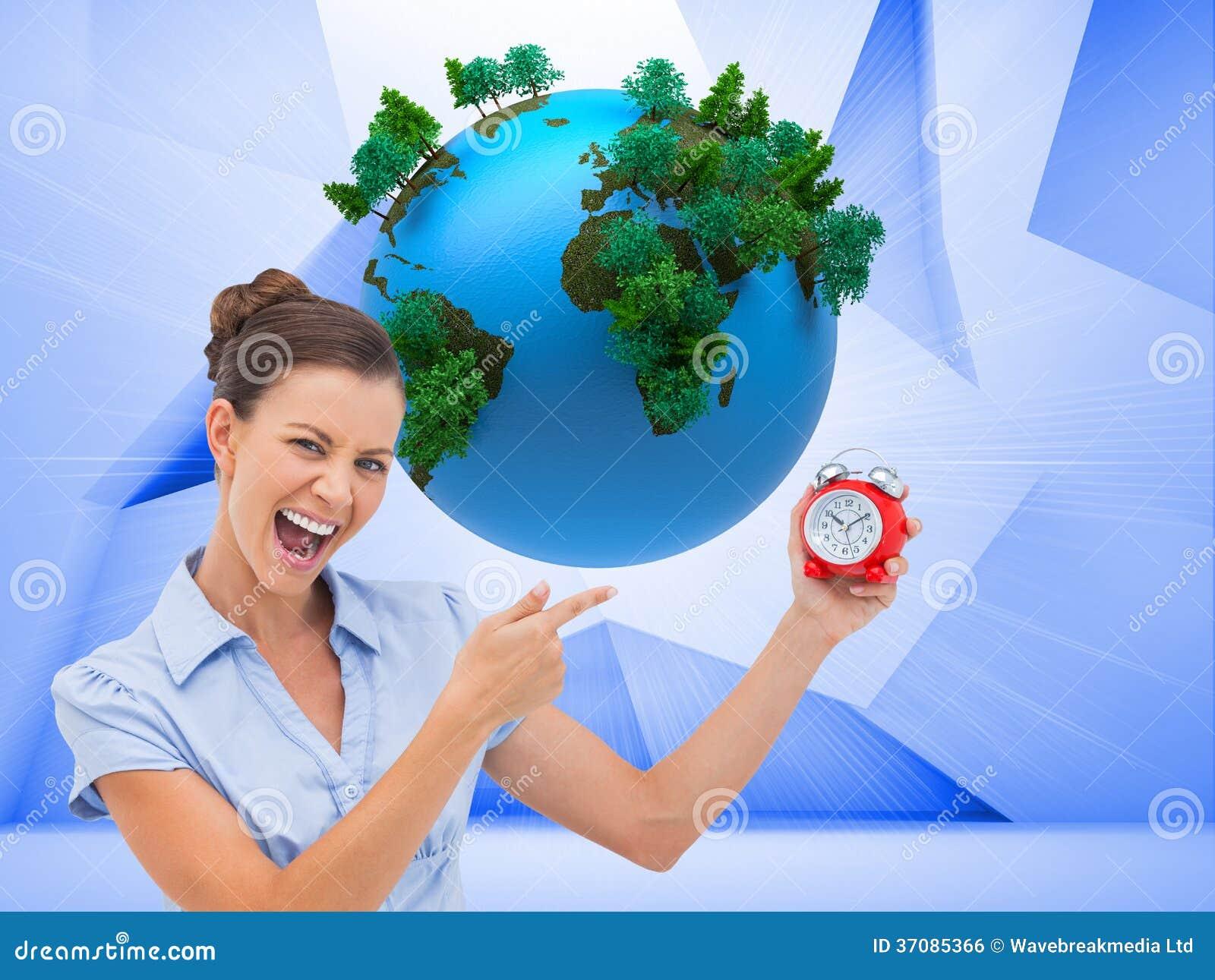 Download Bizneswomanu Wskazujący Budzik Zdjęcie Stock - Obraz złożonej z środowisko, piłka: 37085366