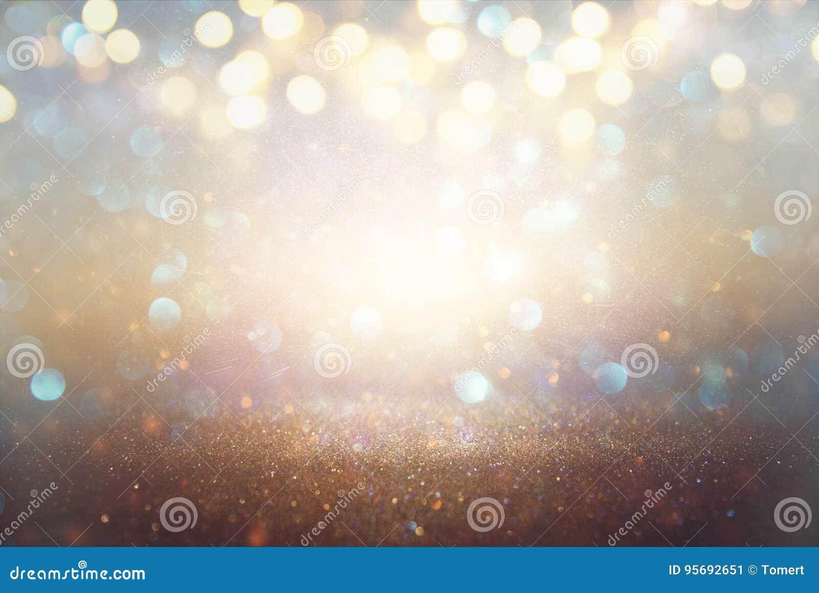 Blänka tappningljusbakgrund ljus silver och guld defocused