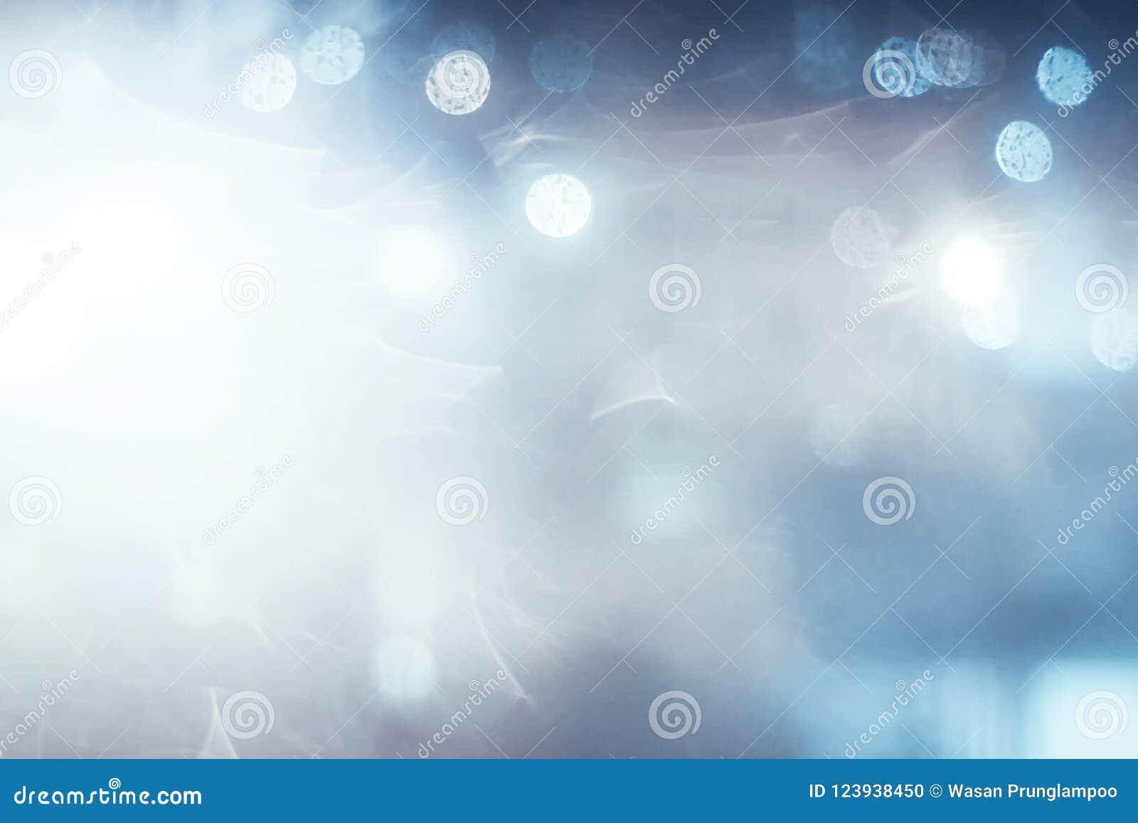 Blå abstrakt bakgrund för bokeh och för ljus
