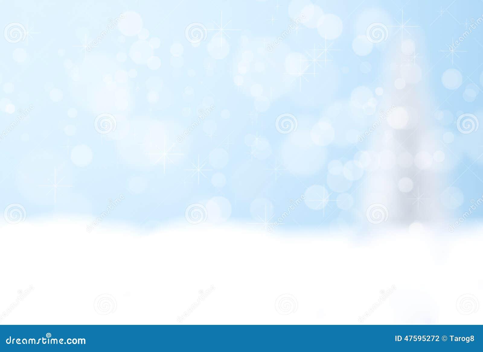 Blå bokehbakgrund av silverjulträdet
