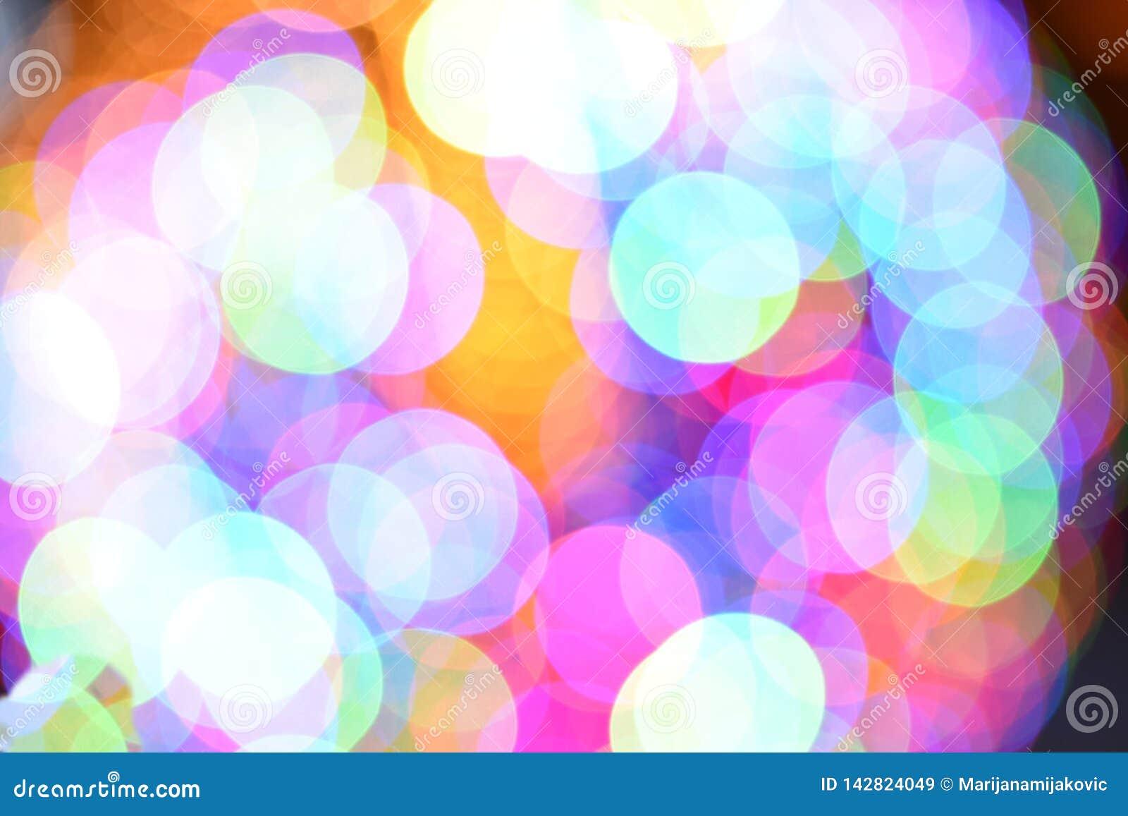 Blå och rosa bokehbakgrund för mycket ljust färgrikt ljus -