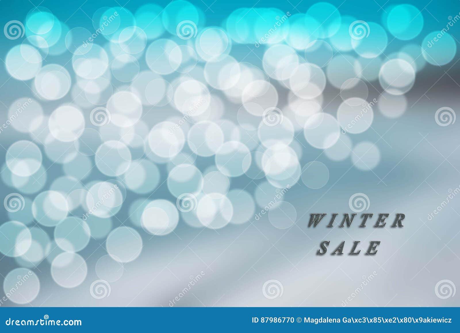 Blå och vit bokehbakgrund på den blåa vinterförsäljningen