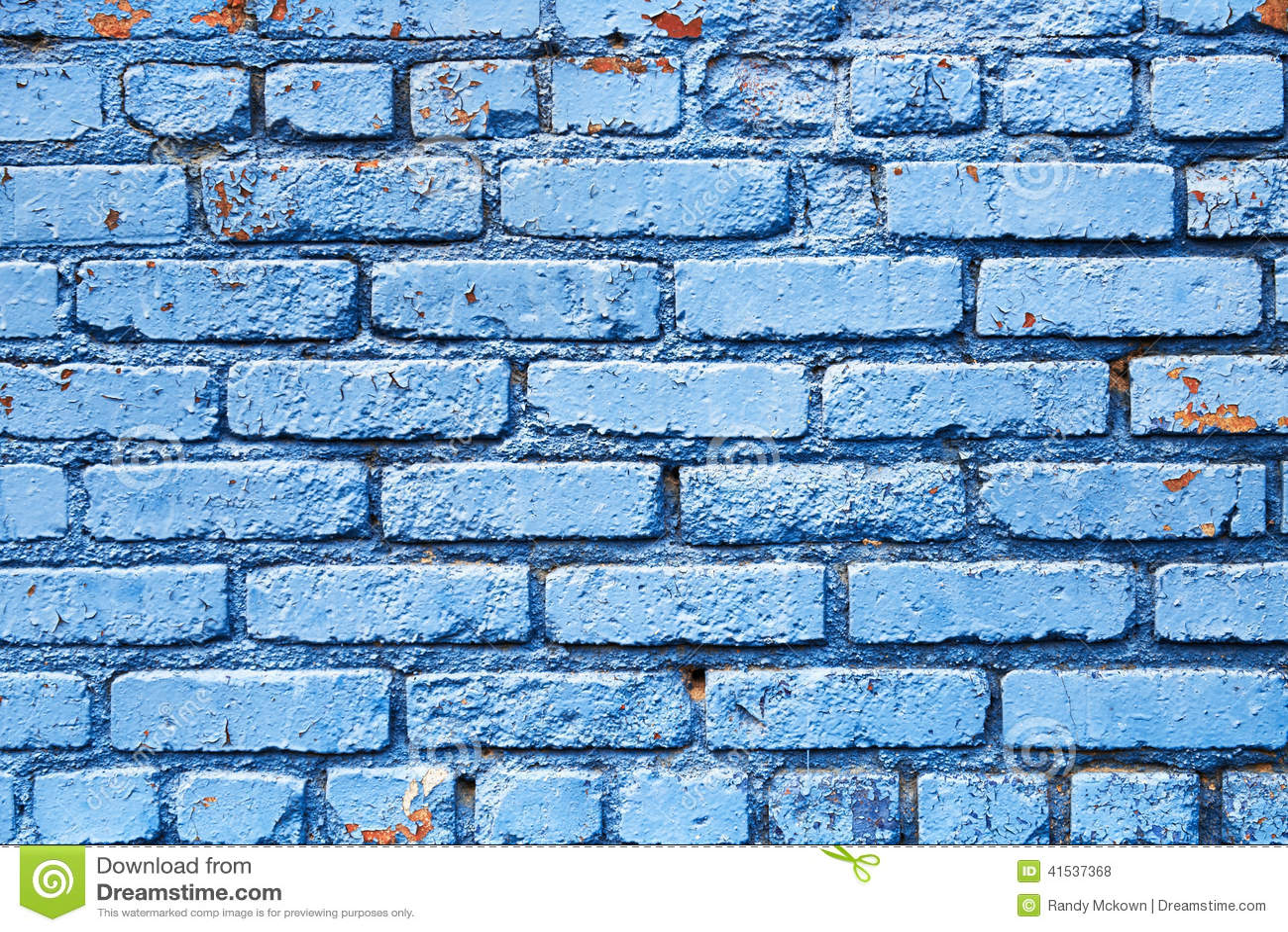 Blå tegelstenvägg med textur för skalningsmålarfärgbakgrund