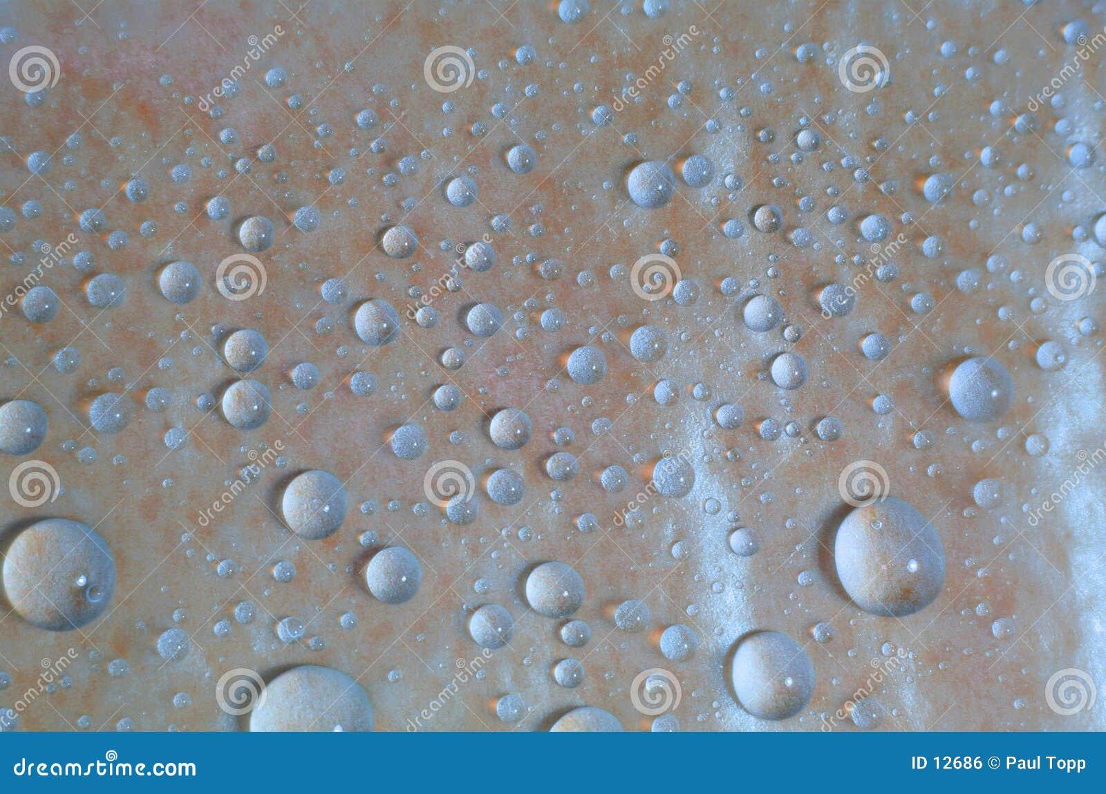Blått liten droppevatten för bakgrund